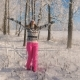 Woman Enjoying Winter Outdoors Whirling under the Snowfall - VideoHive Item for Sale