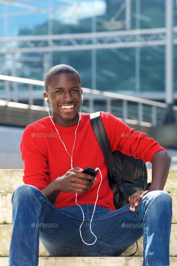 Young handsome african man with mobile phone - Stock Photo - Images