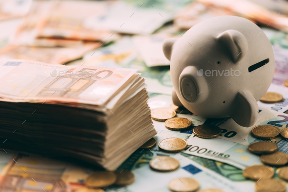 Piggy moneybox with euro cash - Stock Photo - Images