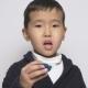 Asian Child Preparing To Eat Washing Powder Pod Preparing To Eat a Capsule with Detergent, Washing - VideoHive Item for Sale