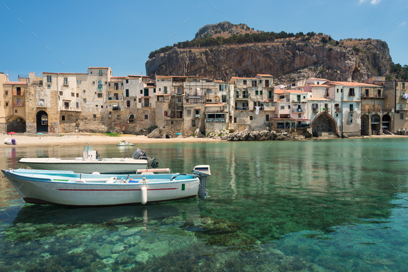 Boats and clear water in Cefalu town - Stock Photo - Images