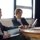 A Business Team of Two Sitting in Office and Check Phone - VideoHive Item for Sale