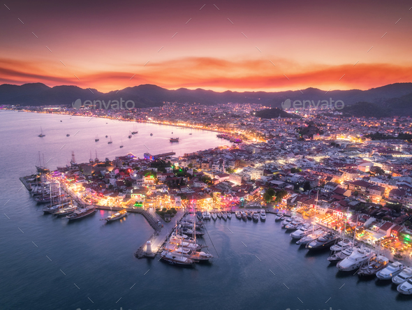 Aerial view of boats and beautiful city at night in Marmaris - Stock Photo - Images