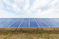 solar panel closeup on the grass in cloudy - PhotoDune Item for Sale