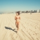 Happy Young Woman Runs at Manhattan Beach in California - VideoHive Item for Sale