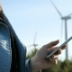 Female Hands Using Cell Phone Near Clean Energy of Windmills - VideoHive Item for Sale