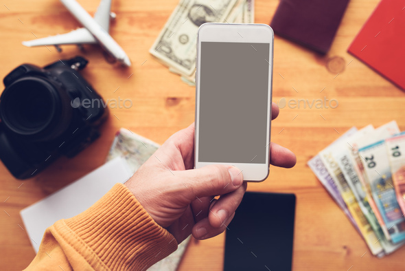 Travel app for mobile phone mock up screen - Stock Photo - Images