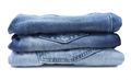 Stack of blue jeans isolated on white - PhotoDune Item for Sale