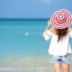 Young Beautiful Woman on White Sand Tropical Beach Back View of Caucasian Girl in Hat Background - VideoHive Item for Sale