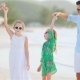 Parents and Adorable Two Kids Have a Lot of Fun during Their Summer Vacation on the Beach - VideoHive Item for Sale