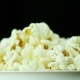 A Glass of Popcorn on a Black Background. Slowly Rotates - VideoHive Item for Sale