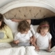 Family Is Using Mobile Devices Lying in the Bed During Weekend at Home Two Kids Is Holding Tablets - VideoHive Item for Sale
