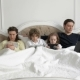 Parents and Kids Using Mobile Devices Together in the Bedroom During Weekend at Home - VideoHive Item for Sale