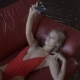 Sexy Young Woman Lying on Sofa and Taking Selfie - VideoHive Item for Sale