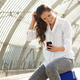 happy woman using smart phone at train station - PhotoDune Item for Sale