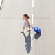 young woman crossing street with mobile phone and suitcase - PhotoDune Item for Sale