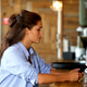 beautiful young woman using mobile at the bar - PhotoDune Item for Sale