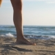 of Female Foot Stepping on the Sand with Sea Waves at Background Beautiful Woman Walking on the - VideoHive Item for Sale