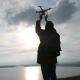 Young Traveler and Flying Drone in Cloudy Sky - VideoHive Item for Sale