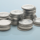 stacks of coins isolated on a reflective surface - PhotoDune Item for Sale