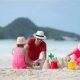 Family Making Sand Castle at Tropical White Beach - VideoHive Item for Sale