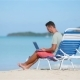 Young Man with Laptop on Tropical Caribbean Beach - VideoHive Item for Sale