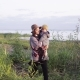 Mom Holding Her Son in Her Arms - VideoHive Item for Sale