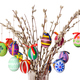 Colored easter eggs on willow bouquet over white - PhotoDune Item for Sale