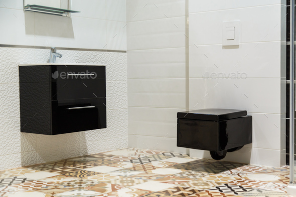 Luxury design of bathroom with black toilet bowl and washbasin - Stock Photo - Images