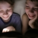 Brother and Sister Read a Book Under a Blanket with a Flashlight in a Dark Room at Night - VideoHive Item for Sale