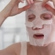 Woman Applying Mask on Her Face Looking in Mirror - VideoHive Item for Sale
