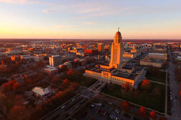 The sun sets over the State Capital Building in Lincoln Nebraska - Stock Photo - Images