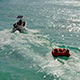 Aerial Boat Tube (donut) Being Pulled behind Boat - VideoHive Item for Sale