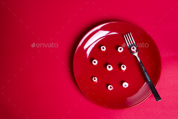 Red hearts candies on red plate. - Stock Photo - Images