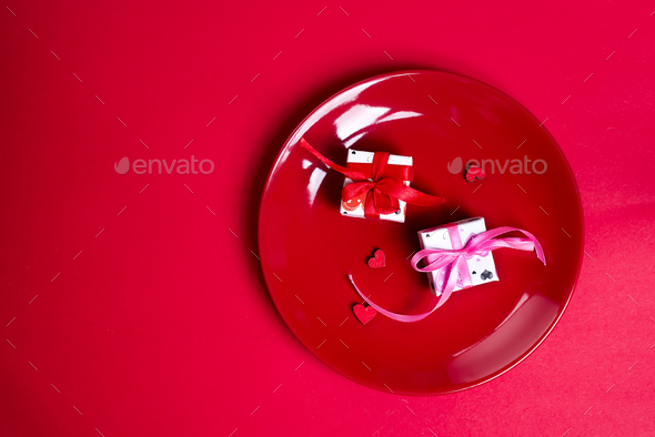 gift boxes on red plate. - Stock Photo - Images