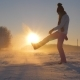 Woman In Winter Field At Sunset Kicked Snow And Glittering Snowflakes And Frost - VideoHive Item for Sale
