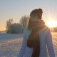 Pretty Woman Frosty Winter Walks Through Snowy Field In Warm Rays Of The Sunset - VideoHive Item for Sale