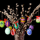 Colored easter eggs on willow bouquet on black background - PhotoDune Item for Sale