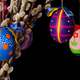 Three colored easter eggs on willow bouquet on black background - PhotoDune Item for Sale