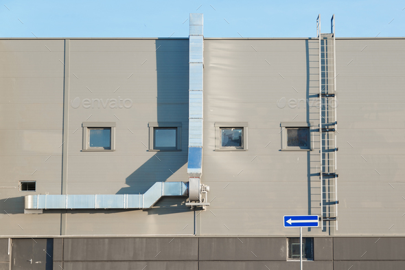Facade of an industrial building with ventilation - Stock Photo - Images