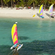 Aerial Shot of Couple Sailing on a Colourful Catamaran Towards Tropical Island - VideoHive Item for Sale