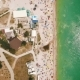 Aerial View of a Crowded Beach in a Sunny Hot Day Yellow Sand and Umbrellas - VideoHive Item for Sale