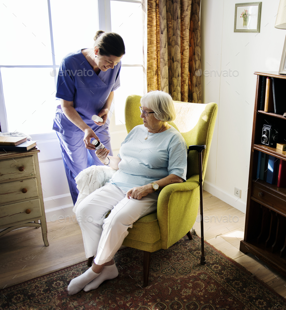 Nurse is taking care of a senior woman - Stock Photo - Images