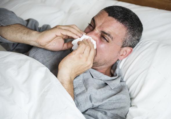 Man sneezing - Stock Photo - Images