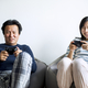 Asian couple playing video games at home - PhotoDune Item for Sale