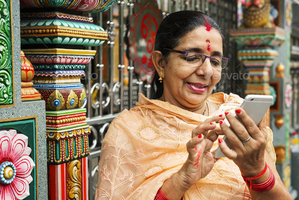 Indian people using mobile phone - Stock Photo - Images