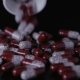 Medical Pills Scattered on the Black Table - VideoHive Item for Sale