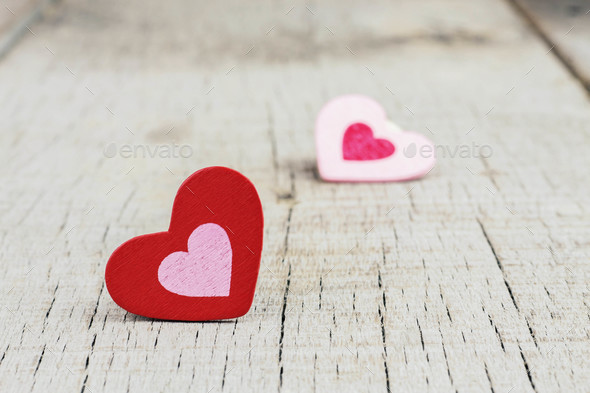Red and pink hearts on wood - Stock Photo - Images