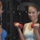 Beautiful Young Woman Working Out with Personal Trainer at the Gym - VideoHive Item for Sale