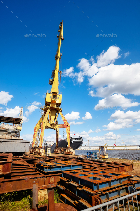 Yellow crane in a shipyard. - Stock Photo - Images